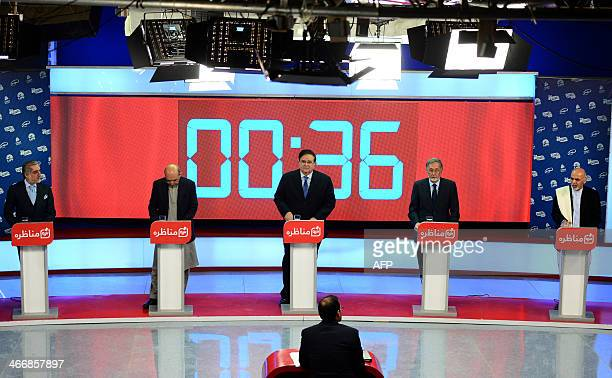 Afghan presidential candidates left to right Abdullah Abdullah Qayum Karzai Abdul Rahim Wardak Zalmai Rassoul and Ashraf Ghani take part in a debate...