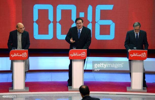 Afghan presidential candidates left to right Qayum Karzai Abdul Rahim Wardak and Zalmai Rassoul take part in a debate at Tolo TV station in Kabul on...