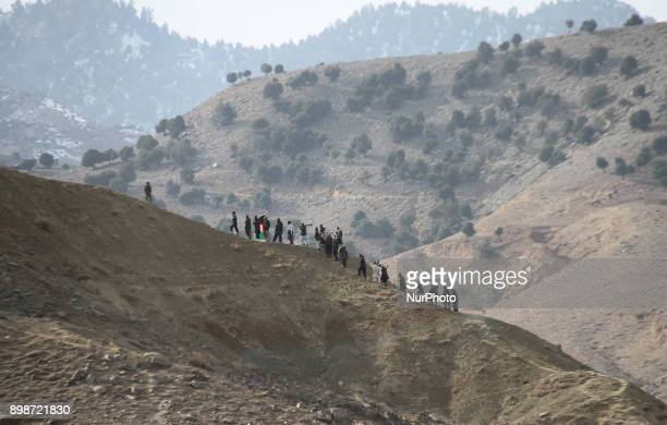 Afghan Private militia comprising of local people patrol in Pachir Agham district near Tora Bora in Nangarhar province Afghanistan on December 25...