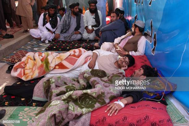 Afghan protesters lie as they receive Intravenous therapy drips during a hunger strike protest inside a tent in Lashkar Gah the capital of Helmand...