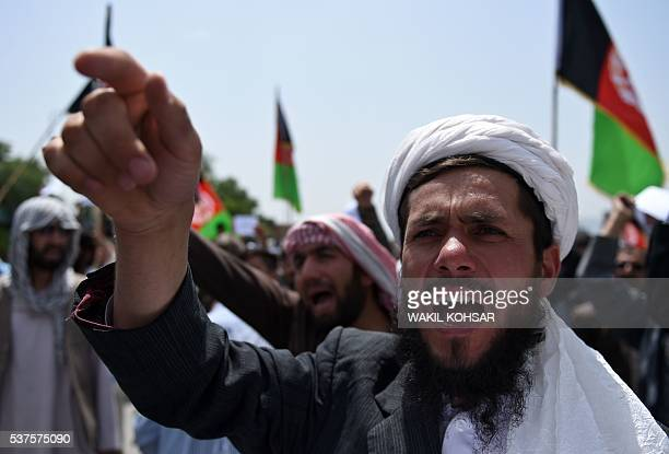Afghan protesters shout slogans during a demonstration against Taliban militants and the kidnapping of civilians in a northern province near the Eid...