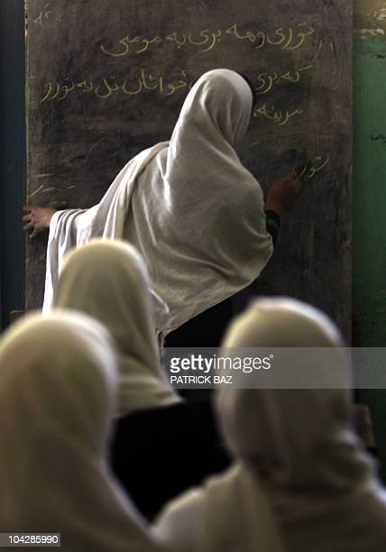 Afghan pupils attend class at a girls school in Kabul on September 20 2010 The Taliban banned female education and work during their brutal 19962001...
