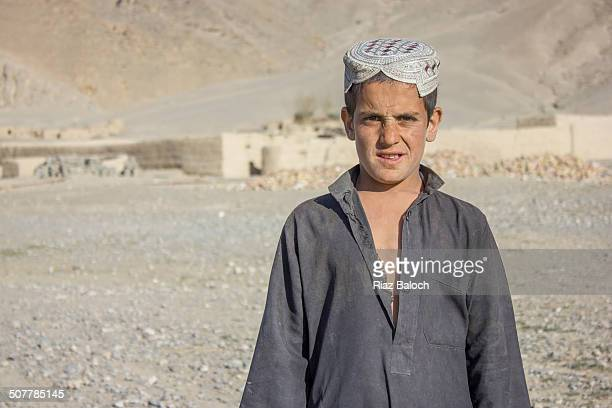 afghan refugee boy - pakistani boys stock photos and pictures