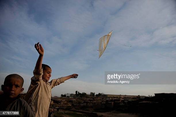 Afghan refugee children living in slums on the outskirts of Islamabad have fun flying kites as the weather warms in Islamabad Pakistan on March 10...