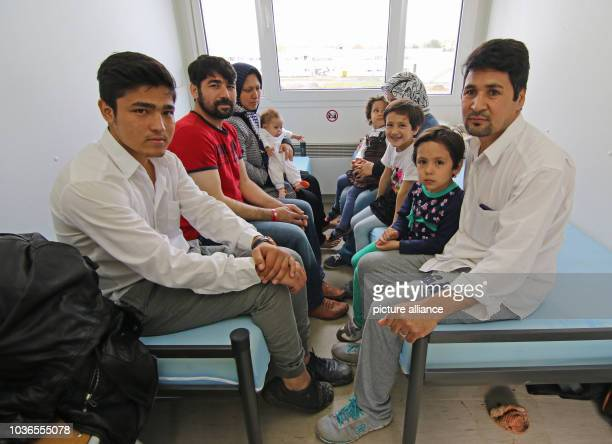 Afghan refugee family Ghazni sits in the central admission facility for refugees in Halberstadt Germany 07 November 2015 with Danial Ali and his wife...