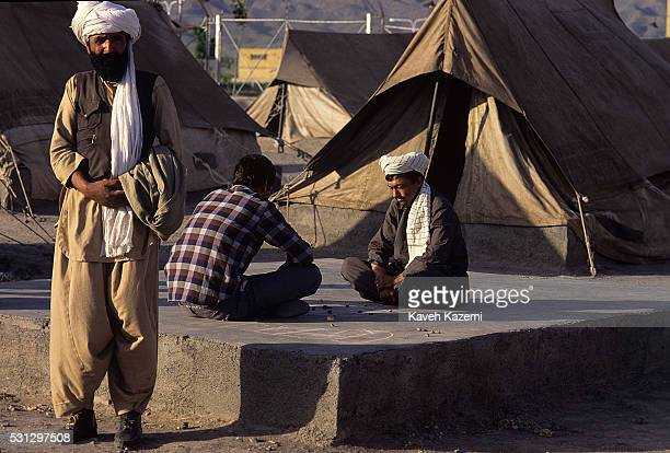 Afghan refugee men seen outside a tent donated by UNHCR in Golshahr neighborhod in Mashhad, Iran on 23rd May, 1988. Due to concentration of Afghan...