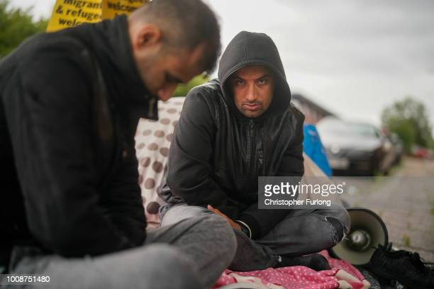 Afghan refugee Rahman Sahah 32 and Mirwais Ahmadzai start their hunger strike outside the HM Government Home Office on August 1 2018 in Glasgow...