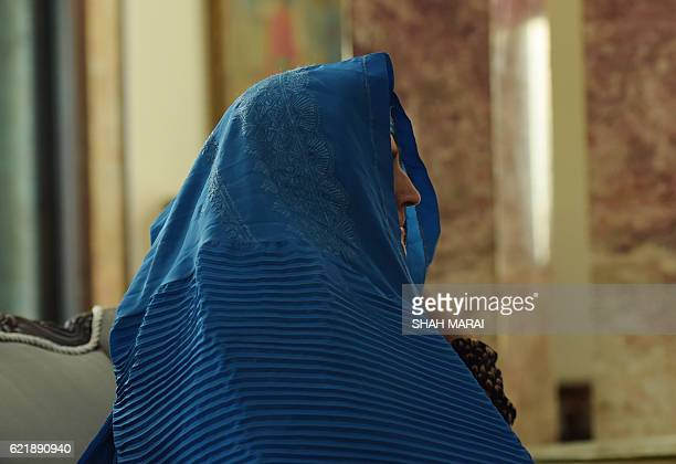 Afghan refugee Sharbat Gula looks on as she meets with Afghan President Ashraf Ghani at the Presidential Palace in Kabul on November 9 2016 An Afghan...