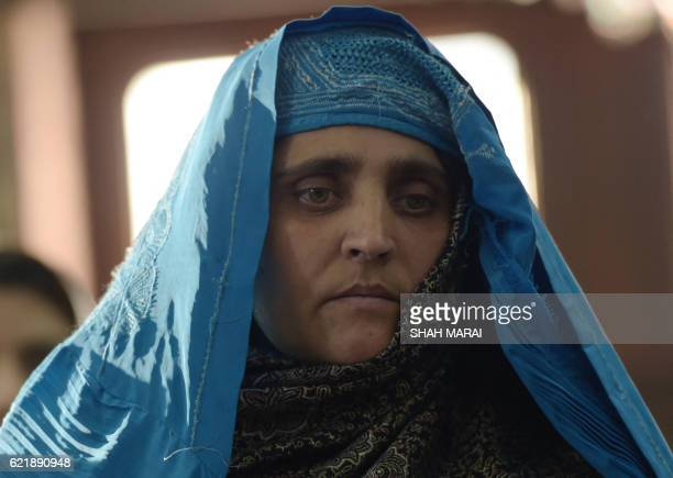 TOPSHOT Afghan refugee Sharbat Gula looks on as she meets with Afghan President Ashraf Ghani at the Presidential Palace in Kabul on November 9 2016...