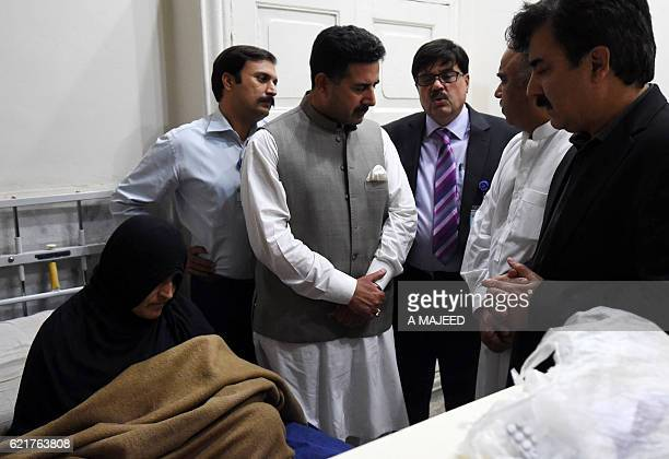 Afghan refugee Sharbat Gula looks on as she meets with Pakistani Khyber Pakhtunkhwa provincial and hospital officials at the Lady Reading Hospital...
