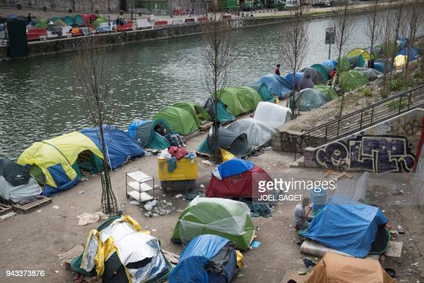 Afghan refugees are seen in a makeshift camp in Paris on Avril 8 2018 / AFP PHOTO / JOEL SAGET