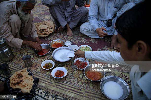 Afghan refugees break their fast at a refugee camp in Islamabad Pakistan on June 19 2015