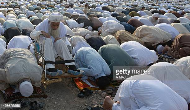 Afghan refugees offer Eid alAdha prayers in Peshawar on October 4 2014 Eid alAdha or Muslim Feast of Sacrifice marks the end of the pilgrimage to...
