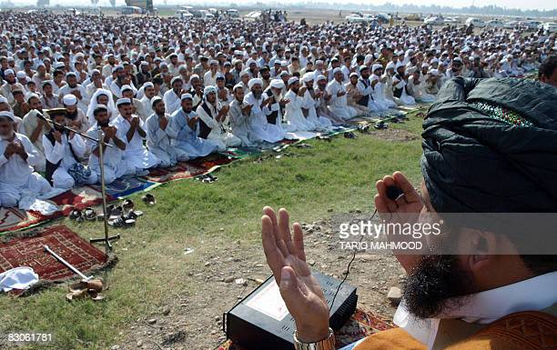 Afghan refugees offer 'Eid alFitr' prayers at a refugee camp near Peshawar on September 30 2008 Millions of Muslims around the world will celebrate...
