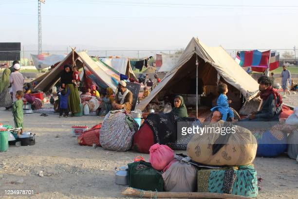 Afghan refugees rest in tents at a makeshift shelter camp in Chaman, a Pakistani town at the border with Afghanistan, on August 31, 2021 after the US...