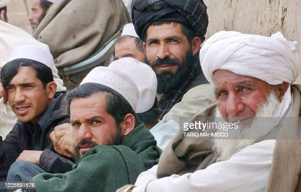 Afghan refugees sit outside a registration office of the Pakistani National Database Registration Authority in Peshawar, 08 February 2007. Pakistan...