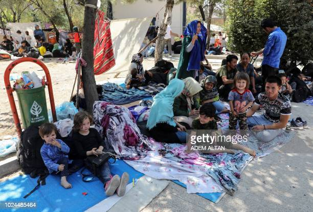 Afghan refugees who arrived ten days ago, rest at a makeshift camp in a park at Cankaya, in the Turkish capital Ankara, on August 27, 2018. -...