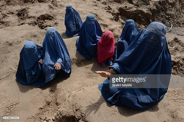 Afghan relatives weep at the scene over the death of their family members in the landslidehit Aab Bareek village in Argo district of Badakhshan on...