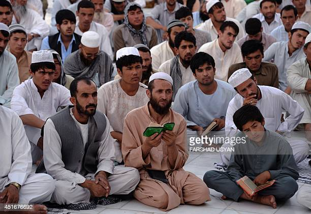 Afghan residents listen to a speech from a religious leader during the Islamic holy month of Ramadan at the Hazrat Ali shrine or Blue Mosque in...