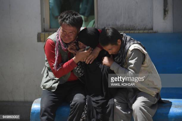 TOPSHOT Afghan residents weep for their relatives following a suicide bombing attack at the Isteqlal Hospital in Kabul on April 22 2018 A suicide...