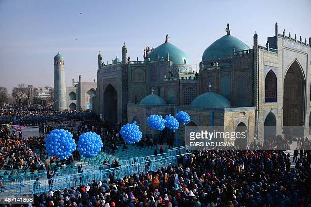 Afghan revellers gather in front of the HazrateAli shrine for Nowruz festivities which marks the Afghan new year in MazariiSharif on March 21 2015...
