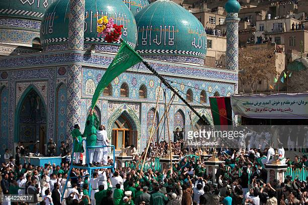 Afghan revellers raise the holy mace at the Sakhi shrine which is the centre of the Afghanistan new year celebrations during the Nowruz festivities...