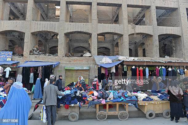 Afghan roadside vendors sell second-hand clothes in central Kabul on December 31, 2009. The Taliban said December 31 it was behind bombings that...
