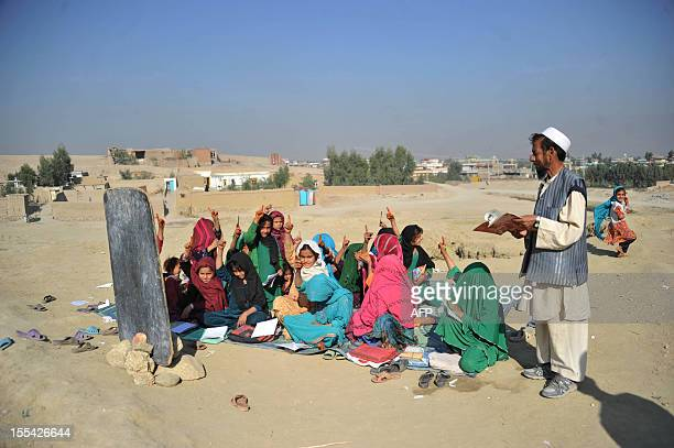 Afghan school children study at an open classroom in the outskirts of Jalalabad on November 4 2012 Afghanistan has had only rare moments of peace...