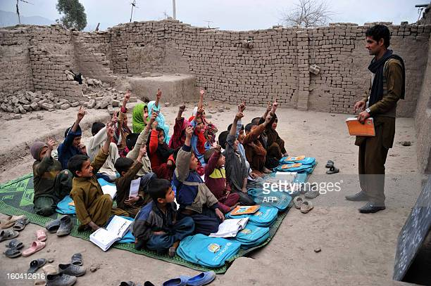 Afghan school children study at an open classroom in the outskirts of Jalalabad on January 30 2013 Afghanistan has had only rare moments of peace...