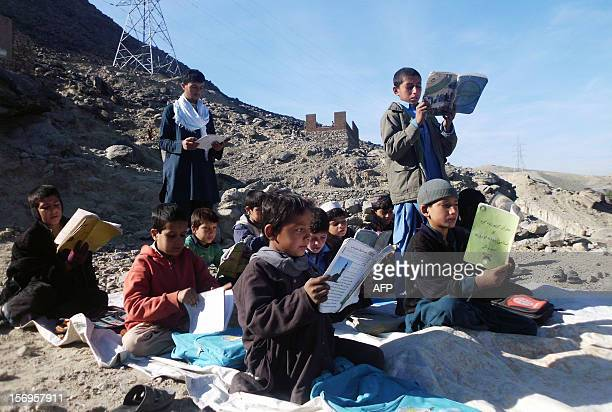 Afghan schoolboys study at an outdoor classroom in the rural district of Laghman province on November 26 2012 Afghanistan has had only rare moments...