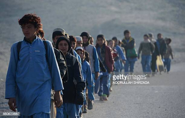 Afghan schoolchildren leave after studying at an openair classroom in the Mohmand Dara district in eastern Nangarhar province on December 18 2014...