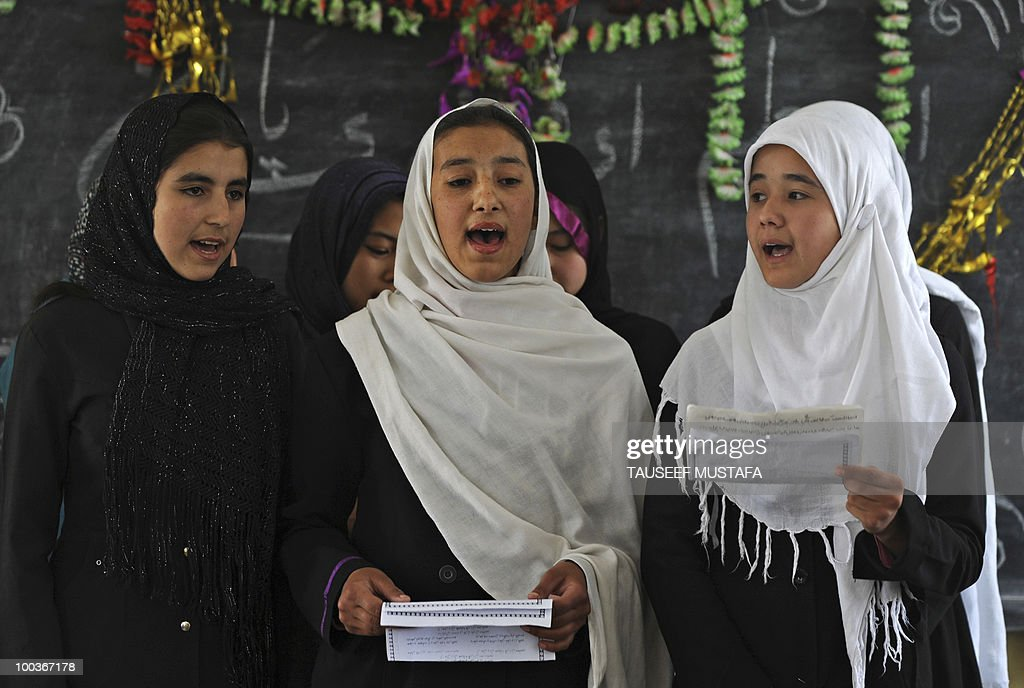 Afghan schoolchildren perform for a World Teacher's Day function at a school in central Kabul on May 24, 2010. Afghanistan has been suffering some sort of armed conflict for the past 30 years, starting with the Soviet invasion of 1979, through civil war and, from 1996-2001, rule by the Islamist Taliban who banned girls from education. This has left a huge knowledge gap that the international community has been trying to fill, with billions of dollars of aid pouring in since the Taliban were pushed out in a US-led invasion. AFP PHOTO/Tauseef MUSTAFA