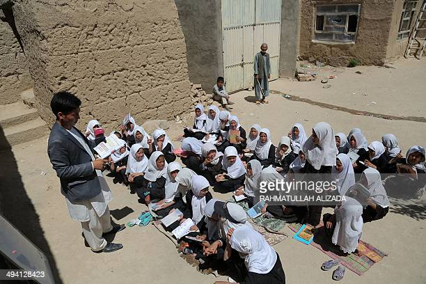 Afghan schoolchildren sit outdoors at an open classroom in Ghazni on May 28 2014 Afghanistan has had only rare moments of peace over the past 30...