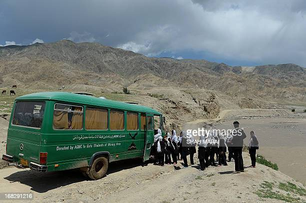 Afghan schoolgirls board a bus in Qara Zaghan village in Baghlan province on May 7 2013 Afghanistan's education minister has threatened to punish...