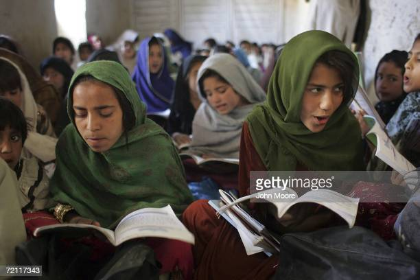 Afghan schoolgirls read aloud during class October 8 2006 near Puli Alam in Logar Province Afghanistan Taliban fighters in recent months have...