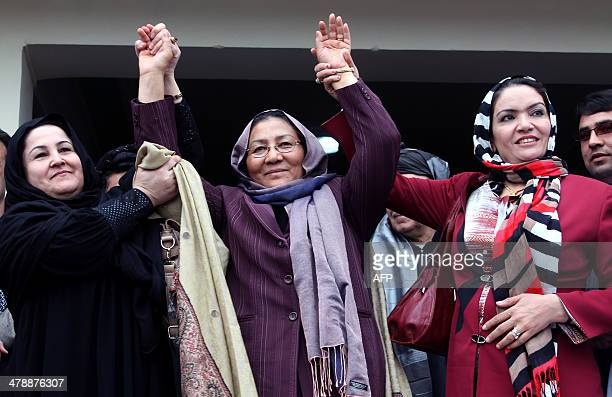 Afghan second vice presidential candidate Habiba Surabi waves as she attends an election rally in Kandahar on March 15 2014 Afghanistan's April 5...