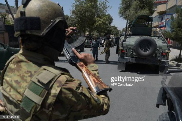 Afghan security arrive at the site of a suicide blast near Iraq's embassy in Kabul on July 31 2017 A series of explosions and the sound of gunfire...