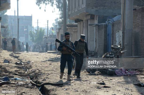 Afghan security force inspect the site of blast near a TV station in Jalalabad on December 2 2017 Three people were killed and eight wounded in three...