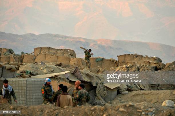 Afghan security force personnel arrive at the site of a car bomb attack in Sherzad district of Nangarhar Province on January 30, 2021.