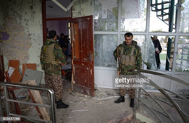 Afghan security force personnel inspect a building used by insurgents to launch an attack on the Indian consulate in MazariSharif on January 5 2016 A...