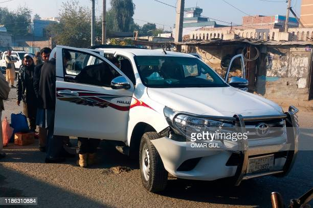 Afghan security force personnel inspect a vehicle, which was carrying Japanese doctor Tetsu Nakamura, following an attack in Jalalabad on December 4,...