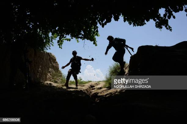 Afghan security force personnel patrol during an operation against Islamic State militants in the Chaparhar district of Nangarhar province on May 21,...