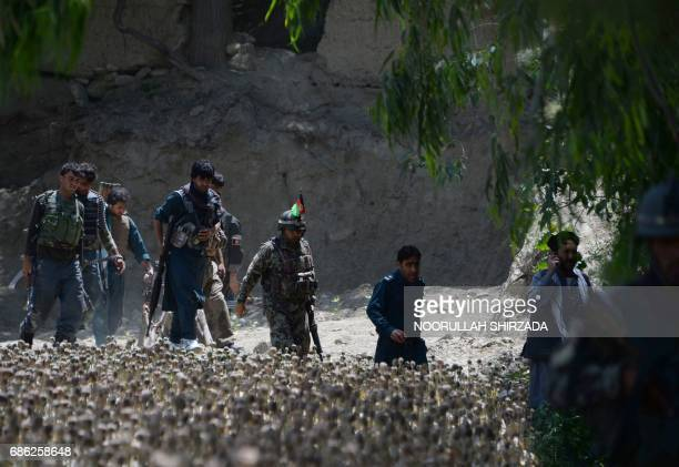 Afghan security force personnel patrol during an operation against Islamic State militants in the Chaparhar district of Nangarhar province on May 21...