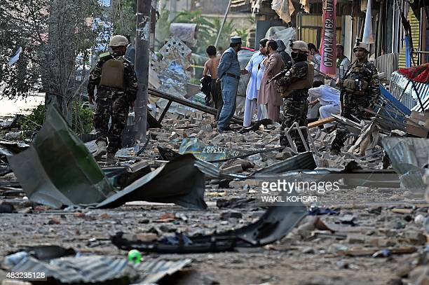Afghan security forces and residents inspect the site of a powerful truck bomb explosion in Kabul on August 7 2015 A powerful truck bomb killed at...