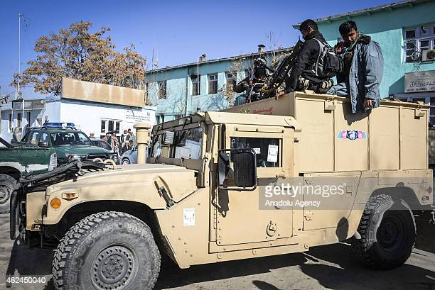 Afghan security forces are seen after a attack staged by Taliban militants to a checkpoint in Andar district killing 11 members of a progovernment...