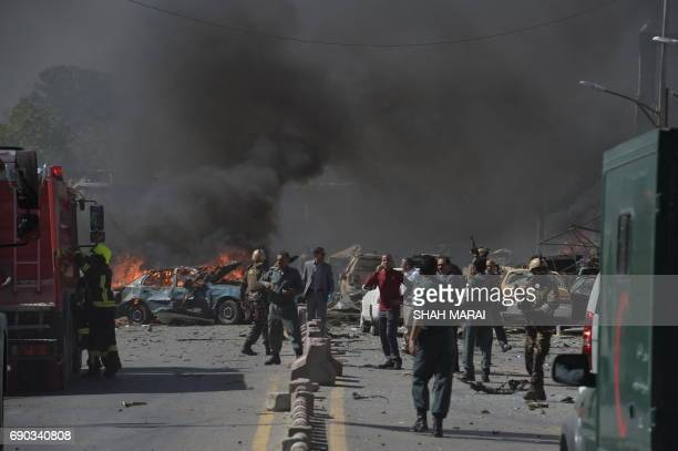 TOPSHOT Afghan security forces arrive at the site of a car bomb attack in Kabul on May 31 2017 At least 40 people were killed or wounded on May 31 as...