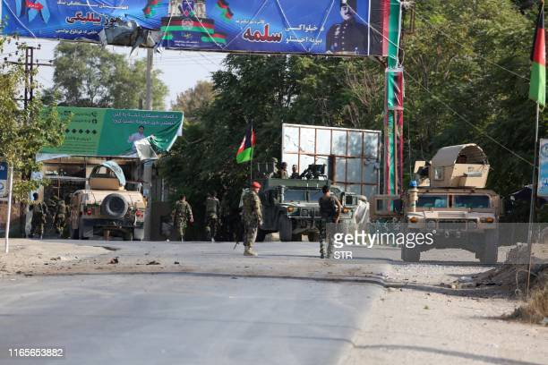 Afghan security forces arrive at the site of a suicide attack near a security forces base on the outskirts of Kunduz on September 2, 2019. - The US...