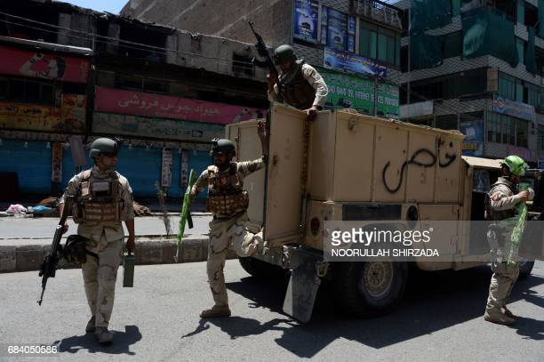 Afghan security forces arrive at the site of suicide bombing in Jalalabad on May 17 2017 Suicide bombers stormed the national television station in...
