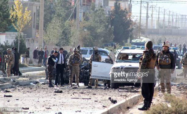 Afghan security forces inspect at site after an attack with a bombladen vehicle in Kabul Afghanistan on November 13 2019 At least seven people were...