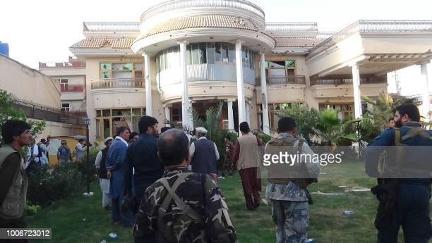 Afghan security forces inspect the building targeted by gunmen during an attack in Jalalabad on July 28 2018 An hourslong militant attack on a...
